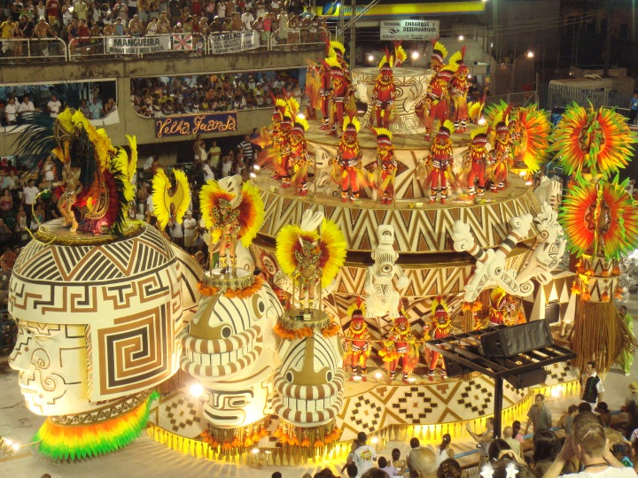 This float was created by the Grêmio Recreativo Escola de Samba Mocidade Independente de Padre Miguel, a major samba school in Rio. Many floats celebrate the rich multicultural history of Brazil, including indigenous, European, and African heritage. Photograph by Sergio Luiz, courtesy Wikimedia. CC BY 2.0