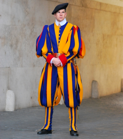 Pontifical Swiss Guards are responsible for the safety and security of the Pope and the Vatican. While they still carry traditional equipment such as a swords, modern Swiss Guards also carry guns. Photograph by Lobozpics, courtesy Wikimedia. CC-BY-SA-3.0