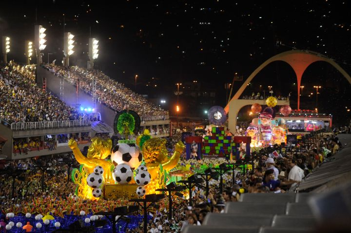 The arch is the end of the 700-meter (765-yard) Rio sambadrome. The bleachers are permanent, and the sambadrome will be home to the archery and marathon events when Rio hosts the Summer Olympics next year. Photograph by Fernando Frazão, courtesy Wikimedia. CC-BY-SA-3.0