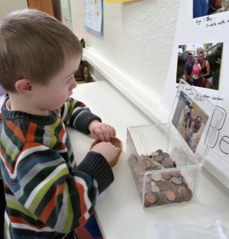 Photo of boy donating money