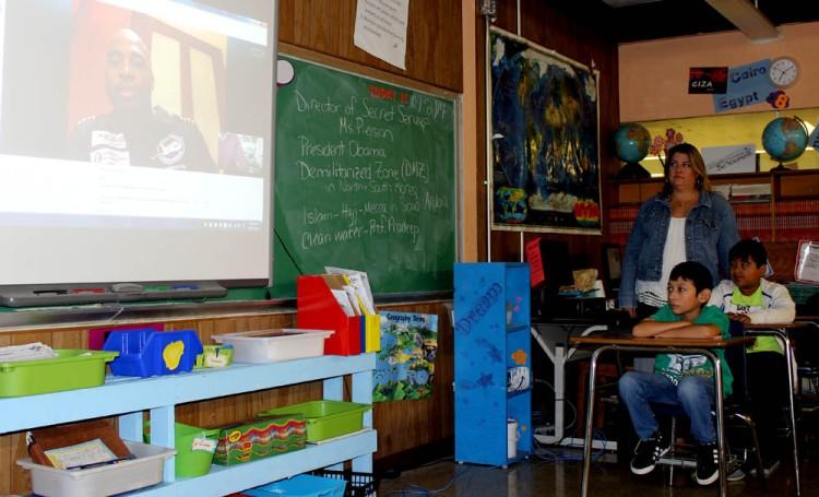 Students talking with Barrington Irving via Skype.