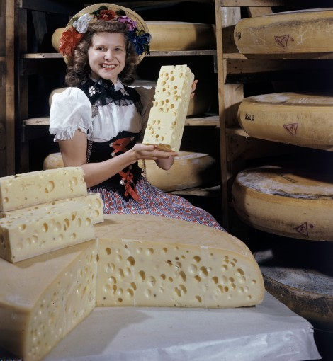 Modern milking methods have changed the texture of Swiss cheese—even Swiss from Wisconsin, as this merry mädchen and her dairy wheels are. Photograph by J. Baylor Roberts, National Geographic