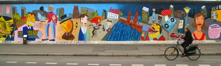 Portions of the Berlin Wall stand today as the mural-adorned East Side Gallery. Photograph by Rae Allen, courtesy flickr. CC-BY-2.0