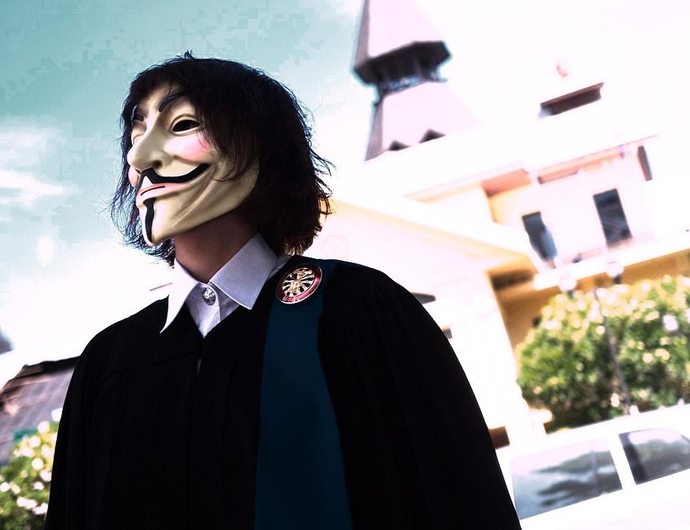 Man wears Guy Fawkes mask