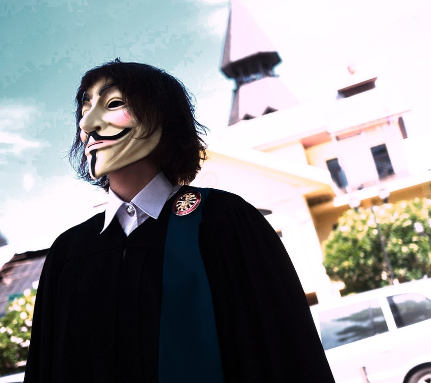 Man wears Guy Fawkes mask