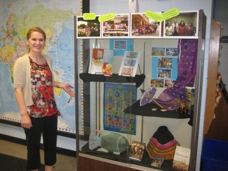 Mariana displays her students' work