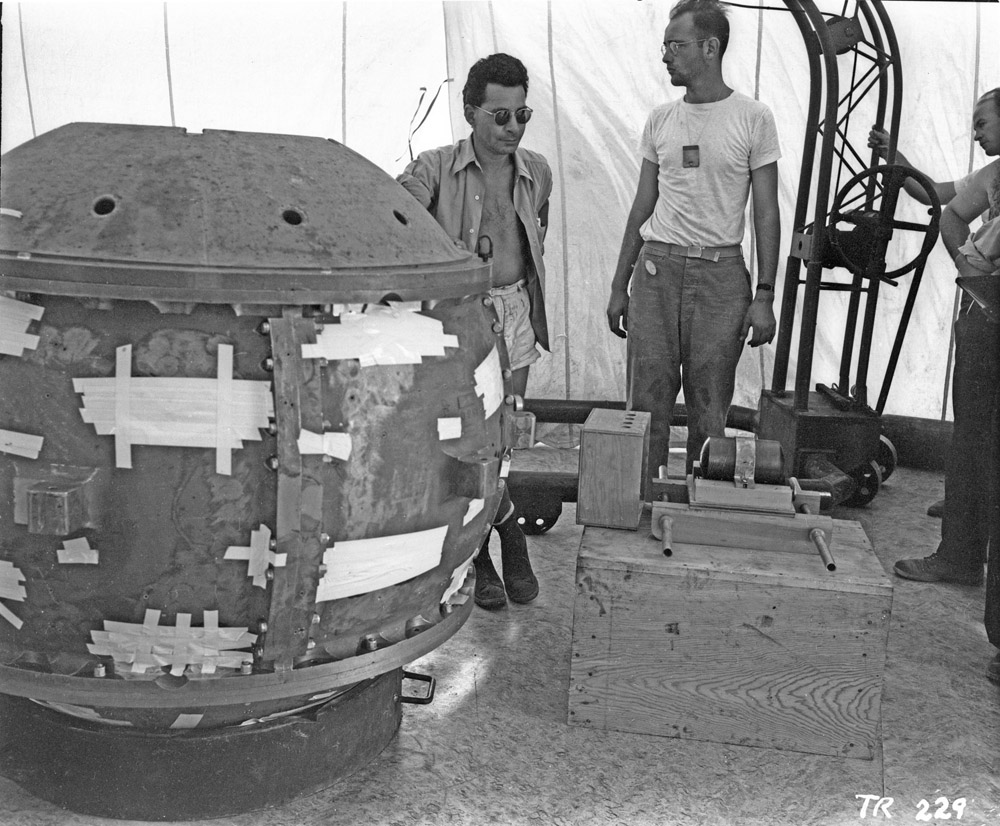 "Manhattan Project scientists Louis Slotin and Herb Lehr help assemble the Trinity ""Gadget""—"