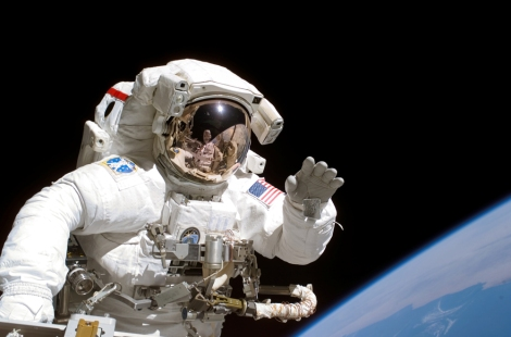 Mission Specialist Joseph R. Tanner waves waves toward the camera of his spacewalk colleague, astronaut Heidemarie M. Stefanyshyn-Piper as the two share extravehicular activity (EVA) duties. The STS-115 astronauts and Expedition 13 crew worked on construction of the International Space Station. Photo by NASA