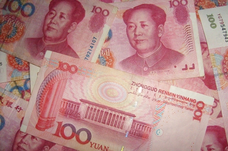 The currency code for yuan renminbi is CNY, and the currency symbol is ¥. One yuan is worth about 16 U.S. cents. (That's young Mao on the 100 yuan bill, of course.) Photograph courtesy Pixabay. Public domain.
