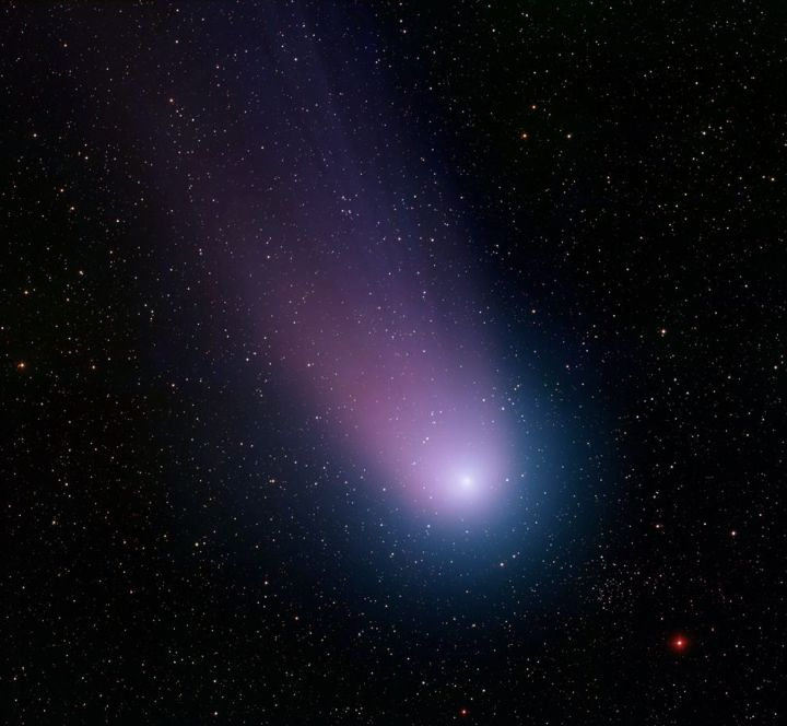 "As comets (like this one, Comet NEAT) approach the sun, solar radiation and the solar wind cause the comet's ""dirty snowball"" nucleus to break up and release gas and dust. Photograph by National Science Foundation"