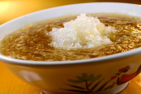 The gelatinous filaments in bird's nest soup aren't noodles, they're strands of softened, solidified saliva from swiftlets that are often bred in facilities to harvest their nests. Photograph by InterContinental Hong Kong, courtesy Flickr. CC BY ND 2.0