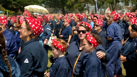 A group of women gather dressed in Rosie the Riveter costumes. Photo by Tom Hilton, courtesy flickr. CC 2.0