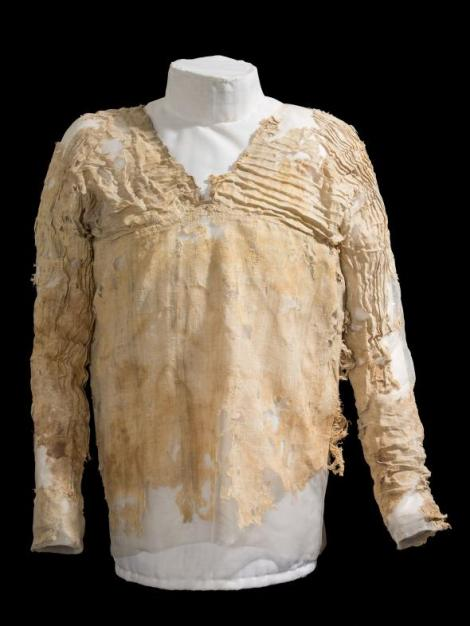 Only the top portion of the elaborately pleated Tarkhan dress survives. It's more than 5,000 years old—how has your oldest piece of clothing held up? Photograph courtesy of UCL Petrie Museum of Egyptian Archaeology