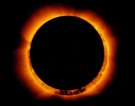 In this picture of a solar eclipse, the moon is beginning to move in front of the sun. Photograph by NASA