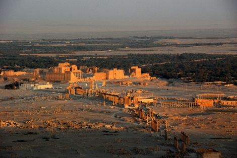 This spectacular 2008 photo of Palmyra, Syria, shows the extent of the city's ancient infrastructure. The huge Temple of Bel complex, which dominates the upper part of the image, has been largely destroyed by ISIS. The Roman amphitheater, gleaming in the middle of the image, is largely intact. Many columns in the gorgeous colonnade are intact, while many have been destroyed by explosives. Photograph by James Gordon, courtesy Wikimedia. CC-BY-2.0