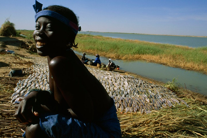 Ibrahim Togola is working to preserve Mali's natural resources to ensure a brighter future for Malian children like this girl. Photograph by James L. Stanfield, National Geographic