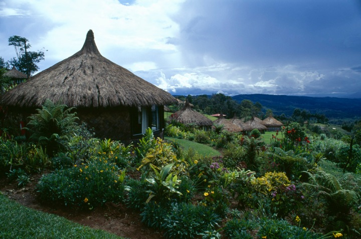 Well-kept houses dot the beautiful landscape of the Eastern Highlands Province of Papua New Guinea. Photograph by Jodi Cobb, National Geographic