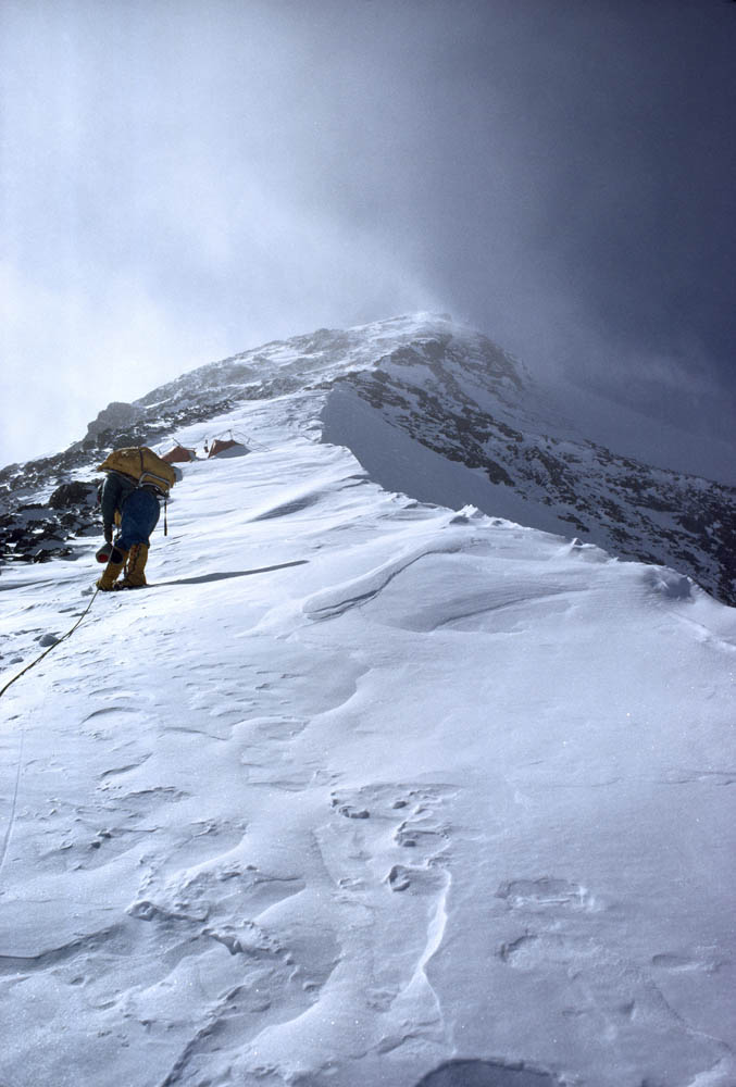 A climber trudges to the last camp before the summit of Mount Everest. Photograph by Barry Bishop, National Geographic