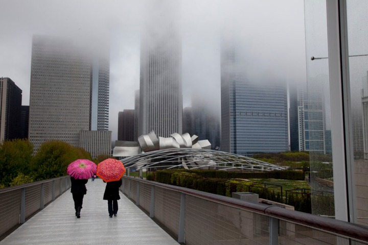 A little fall of rain can hardly keep visitors from the Art Institute of Chicago. Photograph by Melissa Farlow, National Geographic