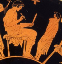 No, he's not using a laptop. This ancient Greek writer (dated to about 500 BCE) is using a wax tablet. Photograph by Pottery Fan, courtesy Museum Berlin. CC-BY-SA-3.0