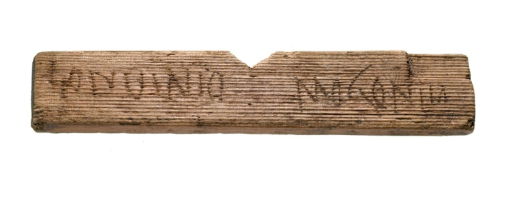 """This fragment of a wooden tablet reads """"Londinio Mogontio,"""" which translates to """"In London, to Mogontius."""" (Mogontius is a Celtic name.) Photograph courtesy MOLA"""