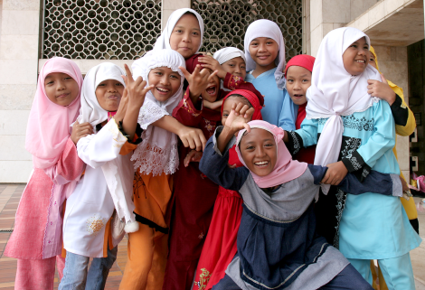 Beautiful Muslim girls mug for the camera at Istiqlal Mosque, Jakarta, Indonesia, in this terrific image. Photograph by Henrik Hansson, courtesy Wikimedia. CC-BY-SA-3.0