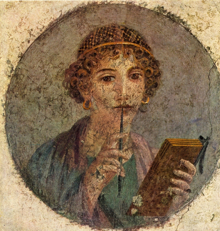 """This stylish woman is holding a wax tablet """"book"""" in one hand and a sharp stylus in the other. This lovely fresco was completed sometime between 55 and 79 CE. We aren't sure of the earlier date, but we know it isn't any later—this fresco was unearthed in Pompeii, which was destroyed in 79 CE.) Photograph courtesy the Naples National Archaeological Museum. Public domain."""