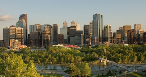 Downtown Calgary, Alberta, Canada, has a pretty skyline, doesn't it? That's the Bow River in the foreground. Photograph by Chuck Szmurlo, courtesy Wikimedia. CC-BY-SA-3.0