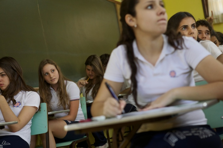 A sixteen-year-old takes her final exams on the last day of school at Colegio Vertice, the top-ranked high school in Sao Paulo, Brazil. Photograph by John Stanmeyer, National Geographic