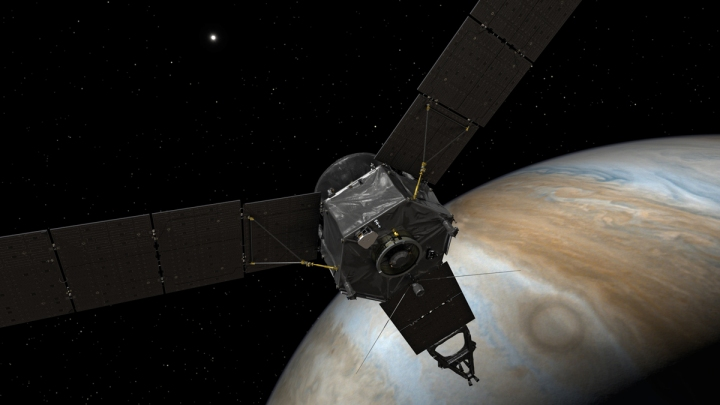 This illustration depicts NASA's Juno spacecraft at Jupiter, with its solar arrays and main antenna pointed toward the distant sun and Earth. Illustration by NASA