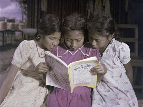 Three sisters share a copy of National Geographic Magazine in La Venta, Tabasco, Mexico, in 1947. Photograph by Richard Hewitt Stewart, National Geographic