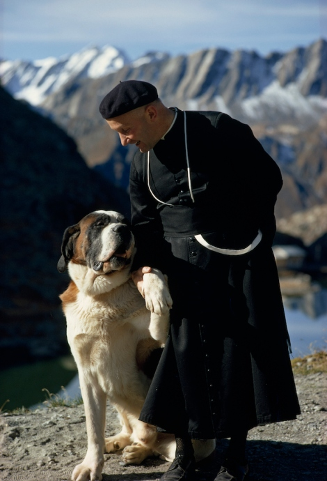 St. Bernard dog with his trainer, an Augustinian monk, atop the Great Saint Bernard Pass in Switzerland. Photo by Thomas J. Abercrombie, National Geographic