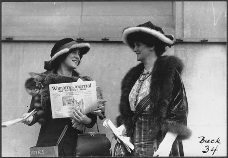 Suffragette Margaret Foley (right) and an unknown woman distribute an early feminist newspaper (1913). Public Domain