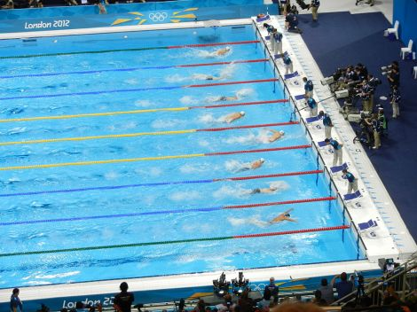 There was no tie for first in this heat of the men's 100-meter butterfly at the 2012 London Olympics—that's Michael Phelps out front. Photograph by Madchester, courtesy Wikimedia. CC-BY-SA-3.0