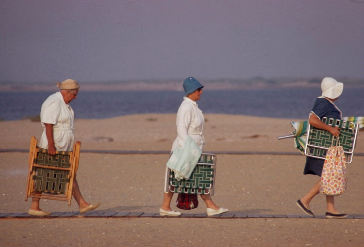 The earliest use of chairs is documented in ancient Egypt, and were symbols of power and authority. Here, beachgoers tote their authority in Nantucket, Massachusetts. Photograph by James L. Stanfield, National Geographic