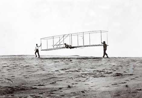 Orville Wright flies the first airplane in Kitty Hawk, North Carolina. Photograph by U.S. Army Air Service, National Geographic