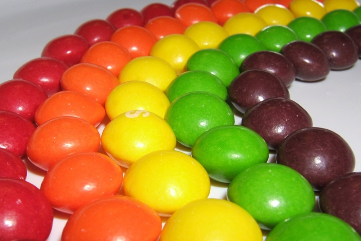 Depending on where you are in the world, purple Skittles could be either grape- or blackcurrant-flavored. Green can be apple or lime. Photograph by Michelle Zlimen, courtesy Wikimedia. CC-BY-2.0