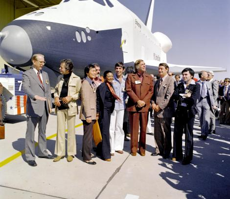 "NASA officials and members of the ""Star Trek"" television series stand by the shuttle Enterprise at its unveiling. Photograph by NASA"