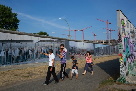 Since German reunification in 1990, the nation has turned the Berlin Wall into an art space and international memorial for freedom. Photograph by Gerd Ludwig, National Geographic