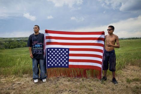 "These Native American protesters are not associated with the Dakota Access Pipeline protests of 2016—they are commemorating the Oglala Lakota occupation of Wounded Knee, South Dakota, in 1973. The upside-down American flag is a symbol of ""dire distress"" and has also been adopted by the pipeline protesters. Photograph by Aaron Huey, National Geographic"