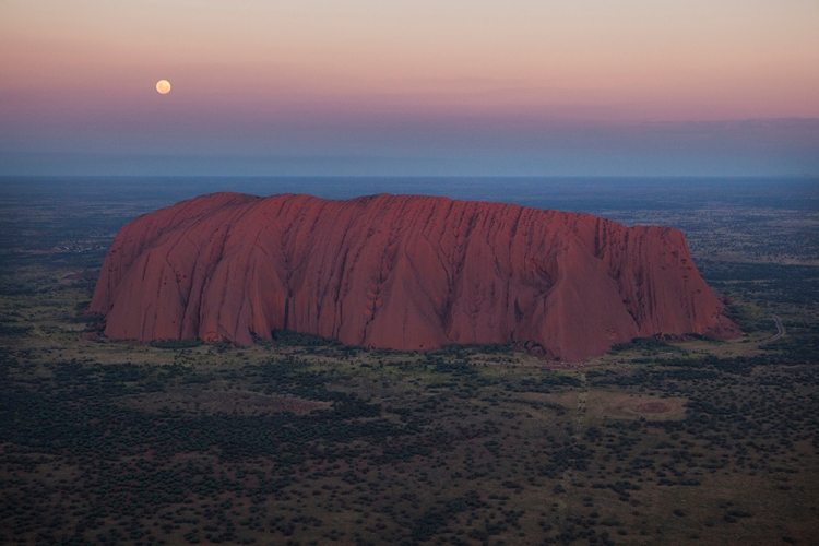 Uluru, the iconic rock formation in Australia's Northern Territory, is a UNESCO World Heritage Site. Photograph by Amy Toensing, National Geographic