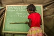 A student in Mozambique learns her numbers, the first step in understanding statistics. Photograph by Thomas P. Peschak, National Geographic.