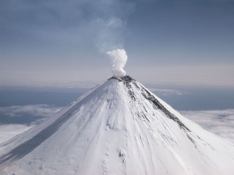 This gorgeous volcanic cone is Shishaldin, a volcano on Unimak Island, Alaska. Photograph by J. Baylor Roberts, National Geographic