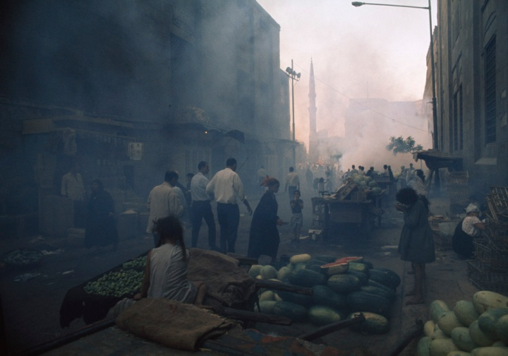 A pesticide fog (designed to kill flies) hangs over a market in Cairo, Egypt, in 1972. Photograph by Winfield Parks, National Geographic