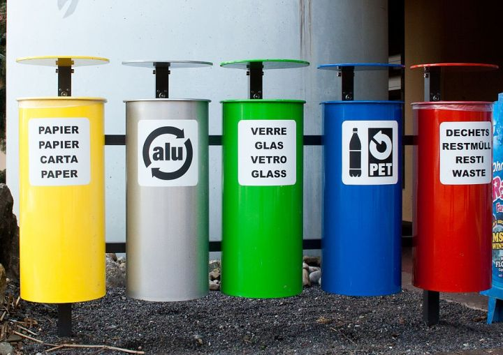 Color-coded bins like these (in the Italian-speaking area of Switzerland) are one of the keys to a successful recycling effort. Photograph by Ludovic Péron, courtesy Wikimedia. CC-BY-SA-3.0