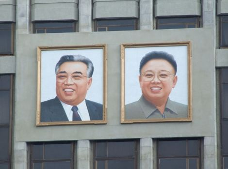 Two of Korea's most famous Kims, Kim Il-sung and his son, Kim Jong-il, smile down from the Mangyongdae Children's Palace in Pyongyang, North Korea. Photograph by Nicor, courtesy Wikimedia. CC-BY-SA-3.0