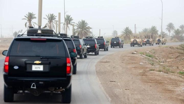 President Barack Obama is somewhere in this security motorcade in Iraq. Photograph by Pete Souza, courtesy the White House