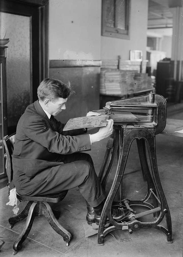 Cartography has changed since this mapmaker made a tactile map for the blind about 100 years ago. Photograph by Bain news Service, courtesy Library of Congress. Public domain