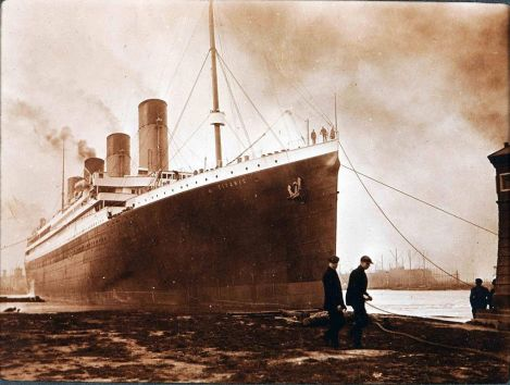 The long black scar in this image of the Titanic would later be crushed by an iceberg. New research suggests a coal fire caused the damage, and structurally weakened the ship. Photograph courtesy Wikimedia. Public domain.