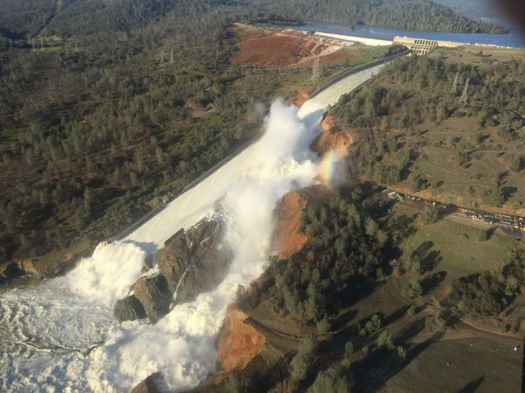 A sinkhole on the main spillway forced water to burst its confines earlier this month. Photograph by William Croyle, California Department of Water Resources
